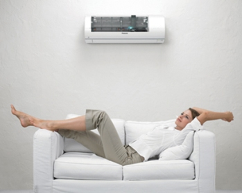 Woman sitting under an air conditioner in Perth