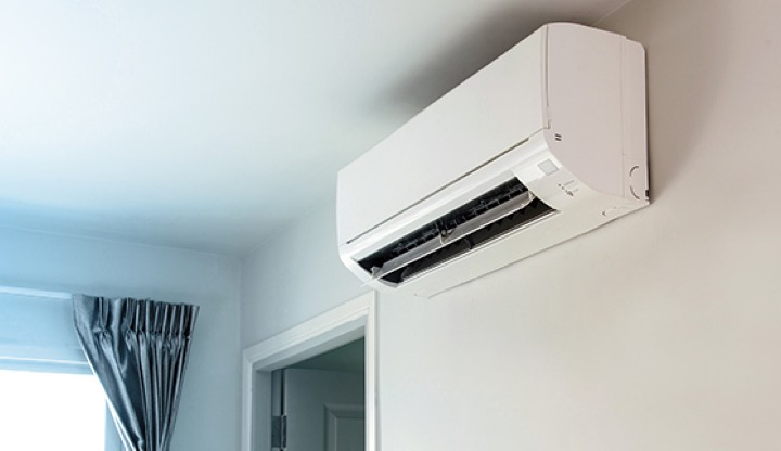 A split system aircon unit installed on a wall.