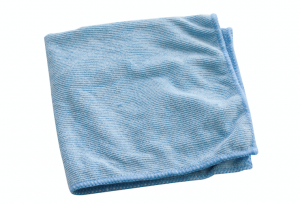 A dish cloth used to clean an air conditioning unit.