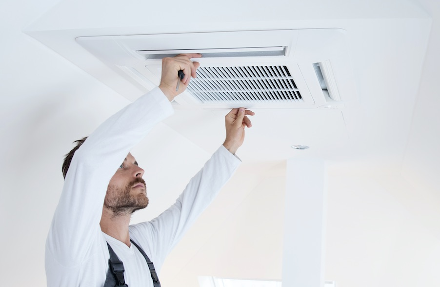 A ceiling cassette airconditioning system being installed.