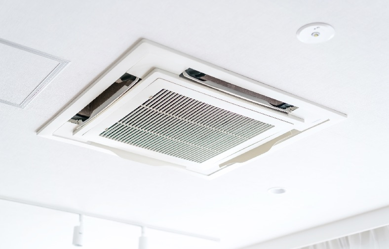 A ceiling cassette mounted air-conditioned in an open plan living area.