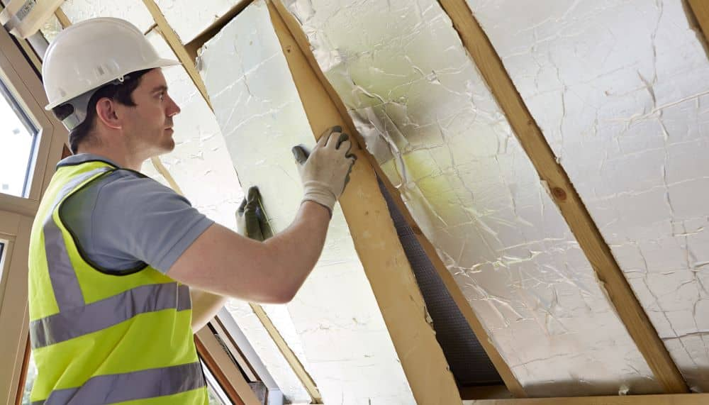 Man installing wall insulation.
