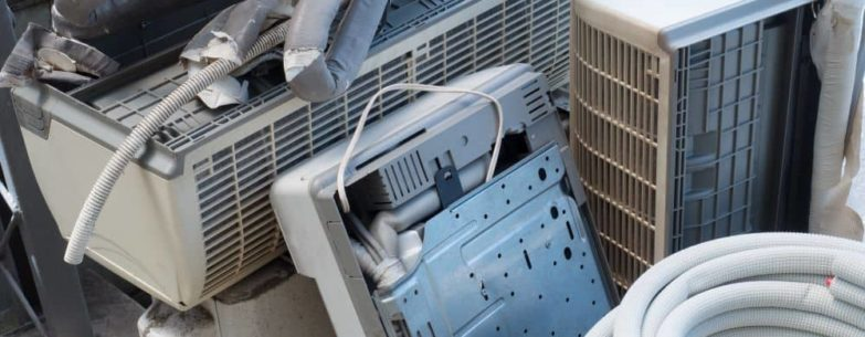 Pile of disposed air conditioning and HVAC units.