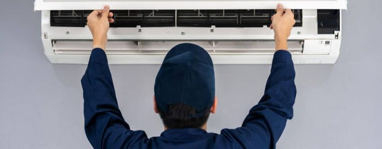 Service man checking air conditioner.