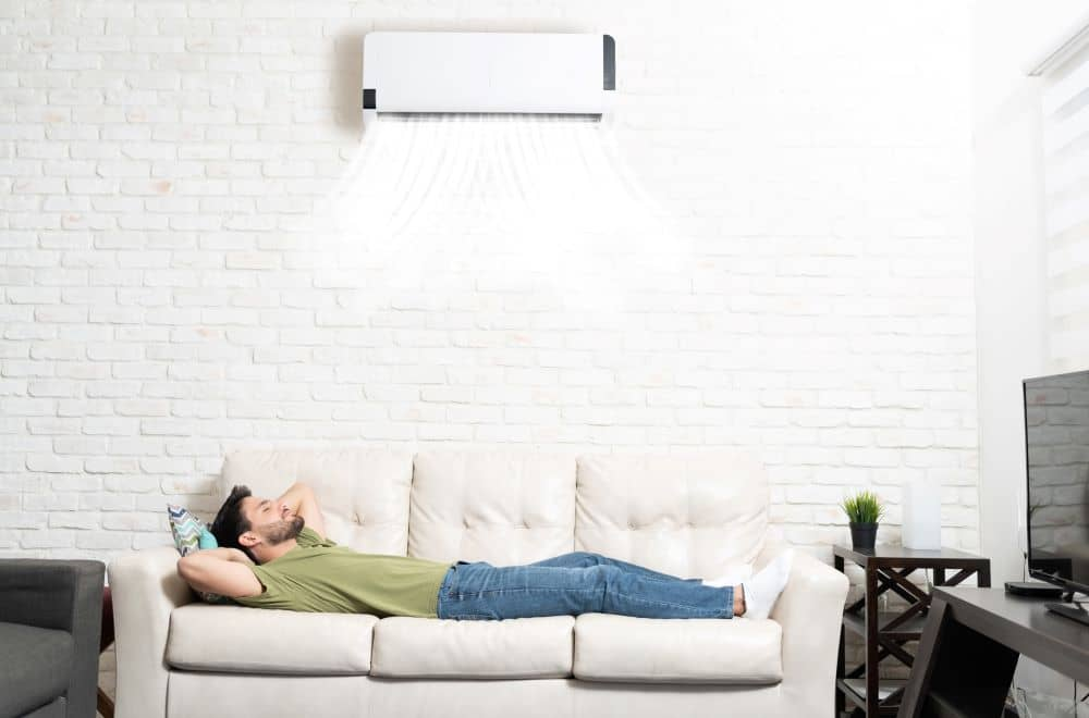 Man relaxing under air conditioner.