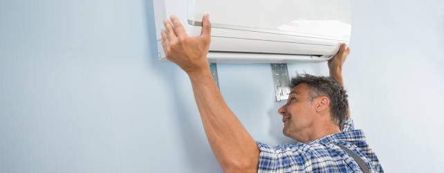 Man replacing air conditioner in Perth